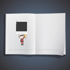 Boy with Santa Claus costume holding a photo