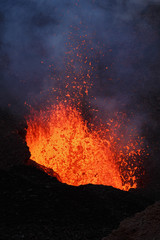 Volcanic landscape of Kamchatka Peninsula: night eruption active Tolbachik Volcano - lava lake, lava flowing in crater of volcano. Russian Far East, Kamchatka Region, Klyuchevskaya Group of Volcanoes.