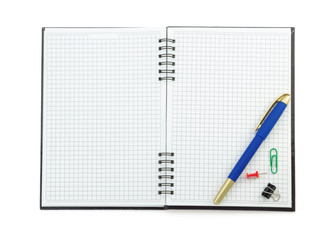 school supplies on checked notebook