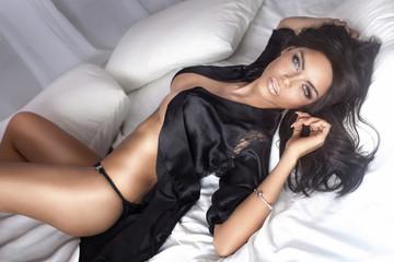 Sexy beautiful brunette lady lying.