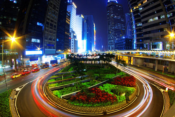 Colorful city night with lights of cars motion blurred in hong k