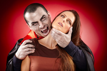 Vampire preparing to bite his victim