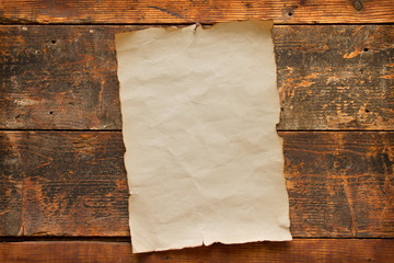 old blank paper nailed to a wooden door