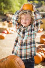 Little Boy Holding His Pumpkin at a Pumpkin Patch.