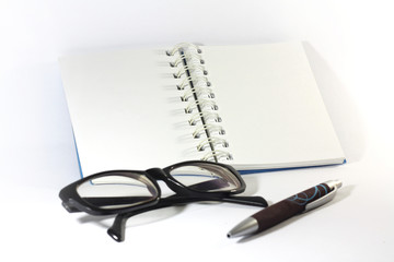 Notebook with pen and eyeglasses