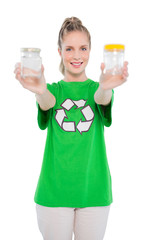 Cheerful environmental activist wearing recycling tshirt holding