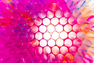Colorful drinking straws close-up background