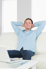 Laughing casual man relaxing with crossed arms