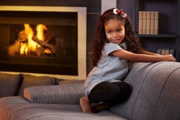 Beautiful afro little girl in the living room
