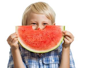 Cute boy hiding behind juciy water melon