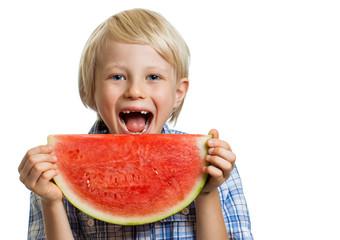 Smiling boy taking bite of water melon