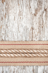 Rope and hardware ribbon on the old wood