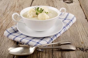 cauliflower soup in a white bowl