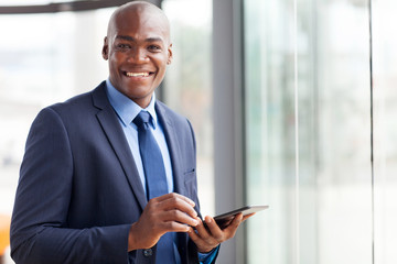 black businessman using tablet pc