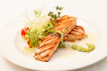 Grilled salmon steak with salad