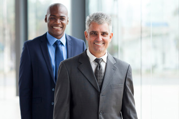 senior businessman and young african businessman