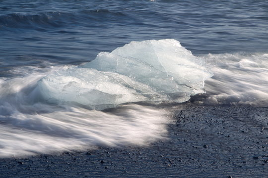.  ice block in the surf of the Atlantic, Iceland