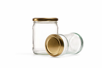 Empty glass jar over white background
