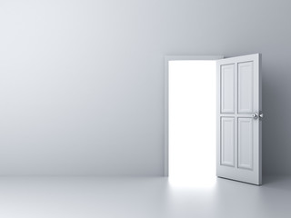 Opened door with bright light on empty white wall background