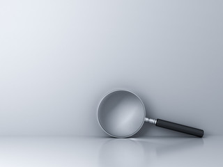 Magnifying glass and empty white wall background