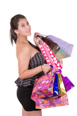 Beautiful hispanic woman with a lot of shopping bags