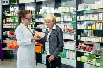 Pharmacist helping a senior lady.