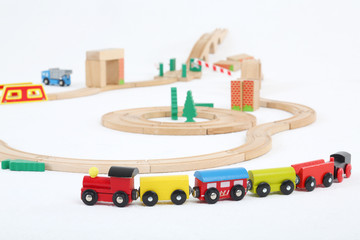 Colored train with cars and wooden toy railway