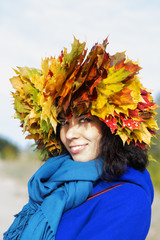Woman with yellow maple leaves on head
