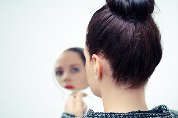 businesswoman looking in the mirror and reflecting