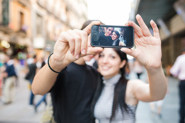 Two young couple taking an autophoto