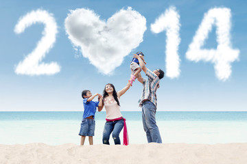 Asian family celebrate new year at beach
