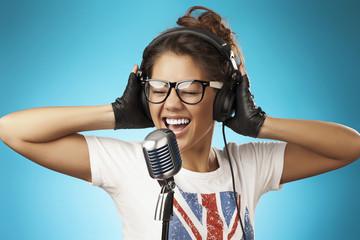 Singing Woman with Retro Microphone. Karaoke