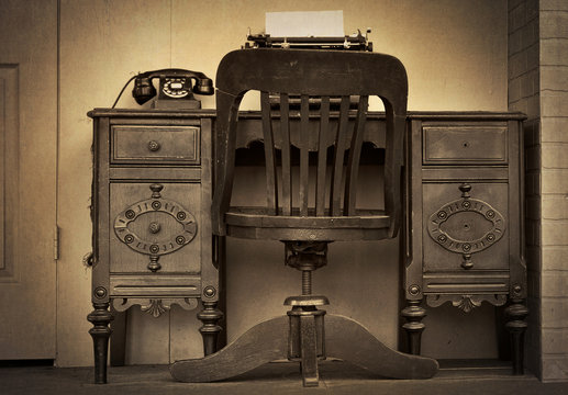 antique desk with rotary dial telephone