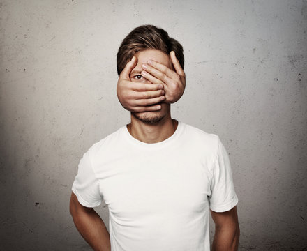 man with hands on his face
