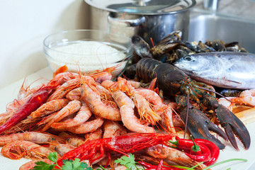 Fresh uncooked sea food specialties and rice