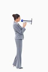 Side view of businesswoman talking through megaphone