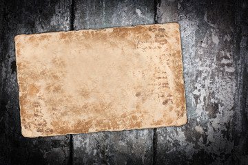 Faded paper sheet on a wooden background