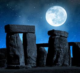 Fotobehang Volle maan Historical monument Stonehenge in night,England, UK