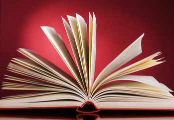 open book on a red background.