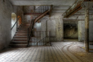 Wall Mural - Old stairs in an abandoned hall