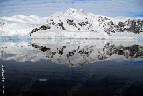 Wall mural mirror calm sea in antarctica