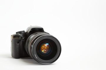 Modern digital photo camera with 24-70mm lens