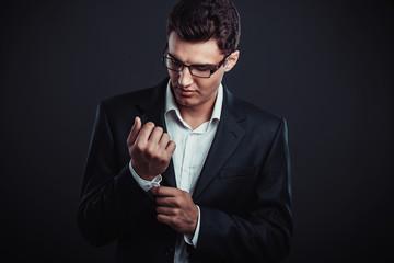 young businessman wearing glasses. Studio shoot.