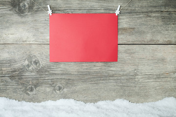 empty red paper sheet on old wooden background