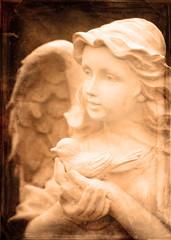Angel Statue Holding Bird