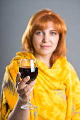 adult woman holding a glass of wine