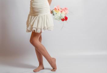 Beautiful girl with flowers studio shot, legs
