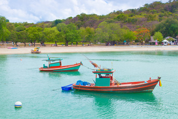 Small fishing boats moored in the sea.