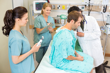Doctor And Nurses Examining Patient