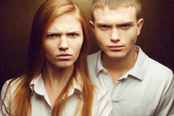 Emotive portrait of angry gorgeous red-haired fashion twins